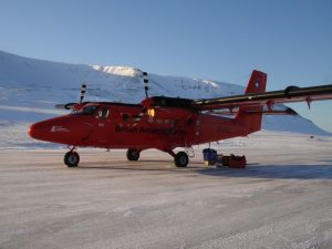 Twin Otter on snow covered runway