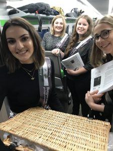 Four students with facsimiles of archival materials