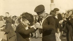 black and white image of Nancy Astor dancing with Naval officer