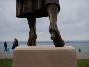 close up of feet of Nancy Astor statue on Plymouth hoe