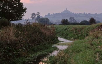 Glastonbury Tor surrounded by marshes (© Mick Sharp)