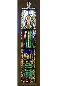 Figure of St Patrick in St Patrick's Chapel Window (© Glastonbury Abbey; photograph: David Cousins)