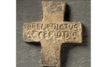A 12th-century lead cross commemorating the burial of Benedict the priest, from St Augustine's Abbey, Canterbury (© Historic England)