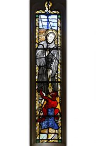 Figure of St Dunstan in St Patrick's Chapel Window (© Glastonbury Abbey; photograph: David Cousins)