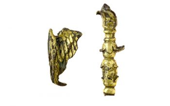 Pilgrim souvenirs excavated at Glastonbury: a tiny gilded wing and sprouting staff from religious figures (© Glastonbury Abbey; photograph: David Cousins)