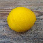single lemon fruit on wood background
