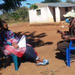 A farmer being interviewed as part of the evaluation of PICSA in Mozambique