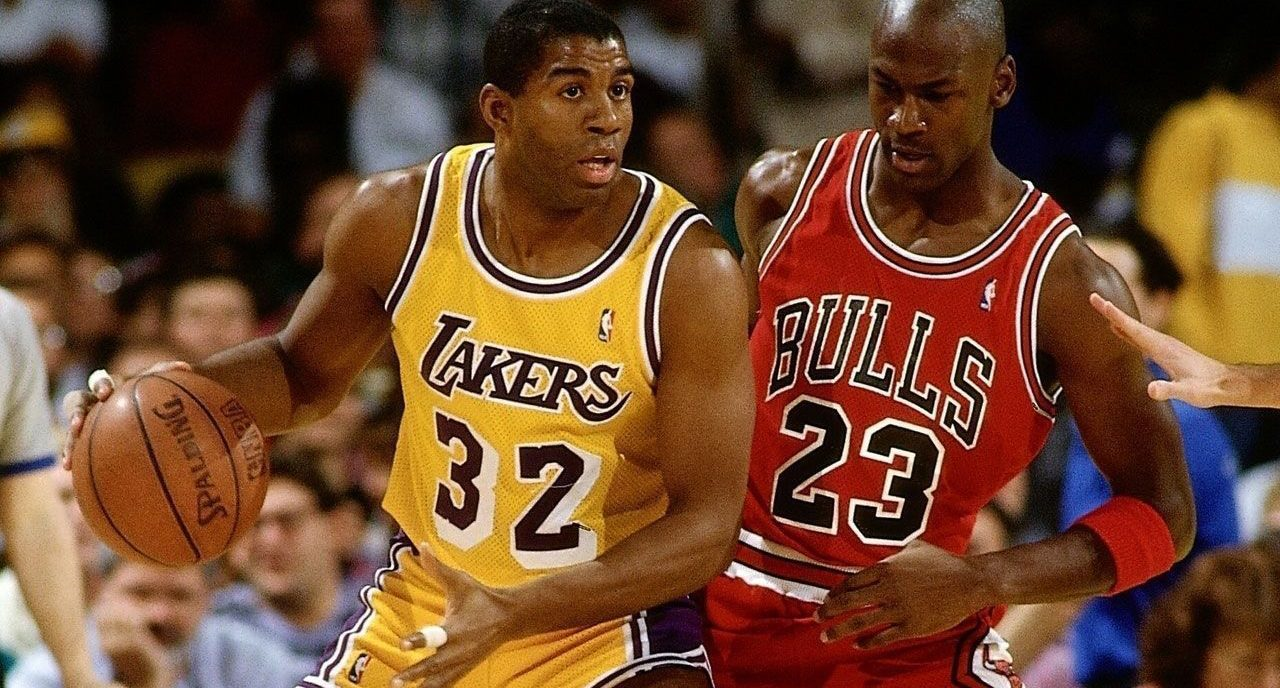 Michael Jordan defends against Magic Johnson